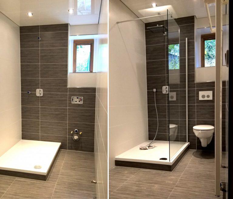 Fliesenarbeiten in einem privaten Badezimmer mit Glasdusche und WC
